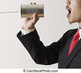 Businessman Shouting into Tin Can Phone