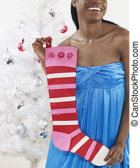 Mid-Adult Woman Holding Christmas Stocking