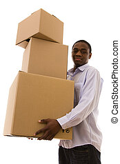 holding the packages - African young man holding a stack of...