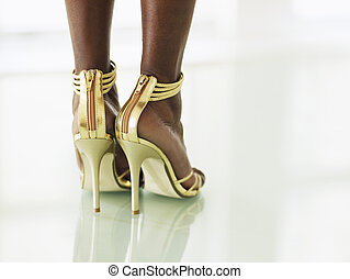 Low Section of Woman Wearing High-Heeled Shoes