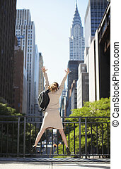 Businesswoman with Backpack Jumping