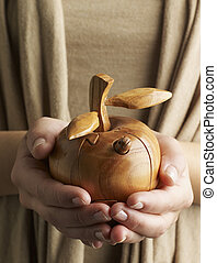 Mid-Adult Woman Holding Wooden Apple