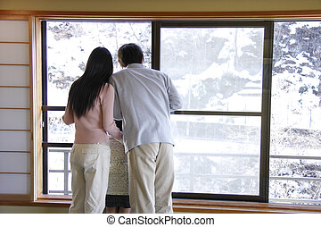 family looking out window