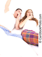 Young couple waking up in the bedroom