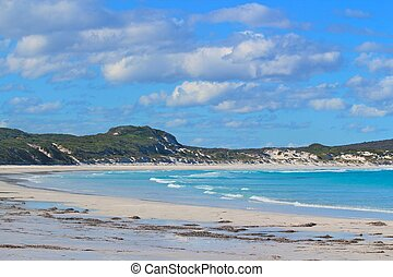 Pristine beach - Turquoise water and white sand under a blue...