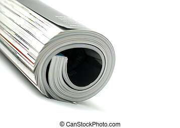 Rolled magazine isolated on white background.