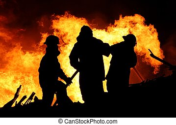 Fire fighters and huge flames - Three firemen fighting a...