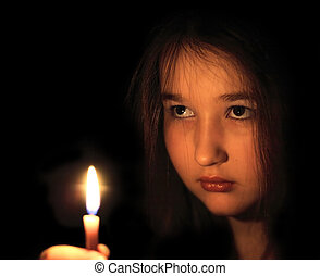 Strength of mind - Portrait of the girl with a candle in...