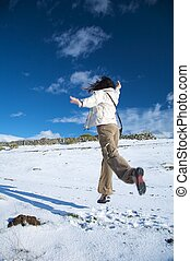 woman jumpping on snow - woman walking on snow at gredos...