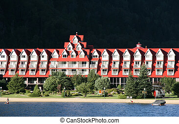 Lakeside holiday resort - Beautiful hotel with red roof on...