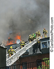 Firefighters on ladder - firemen moving up ladder to battle...