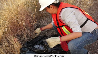 Environmental Girl Cleaning Garbage - Woman dressed in a...