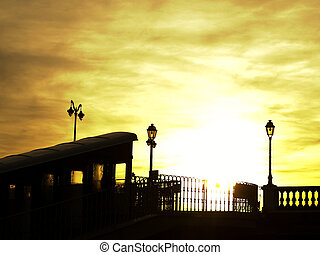 Cable car in Pau at sunset with lampost