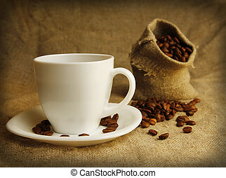 coffee mug and coffee beans - a coffee mug and coffee beans...