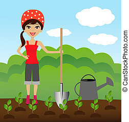 woman plants a nursery transplant - young woman plants a...