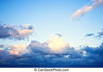 clouds against a backdrop of blue sky