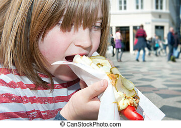 hotdog child lunch fastfood denmark - Child eating hotdog...