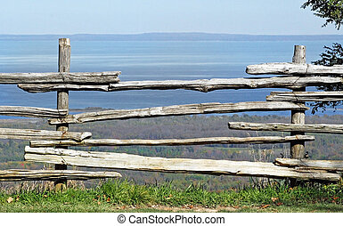 Fence - Weathered wood fencing at edge of cliff with...