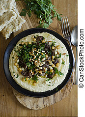 Hummus with lamb meat, chickpeas and toasted pine nuts