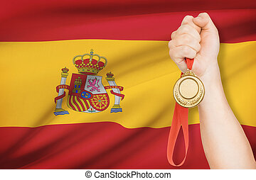 Medal in hand with flag on background - Kingdom of Spain -...