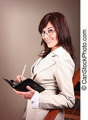 Attractive Businesswoman - Beautiful office executive wrting...