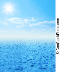 Beautiful sea horizon with clouds above it - Blue sea with...