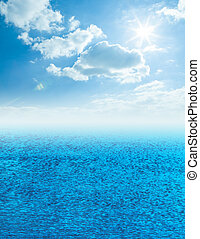 Beautiful sea horizon with clouds above it - Blue sea and...