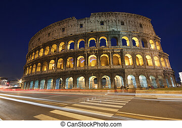 Coliseum - Illuminated Coliseum Colosseo in Italy ar dusk