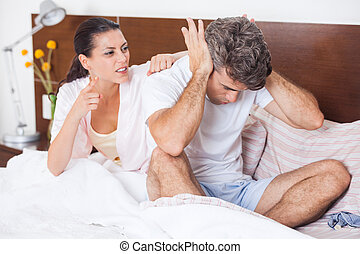 unhappy couple in a bed, conflict problem