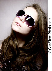 Portrait of the young woman in sunglasses