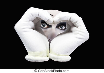 Heart and eyes of mime on a black background