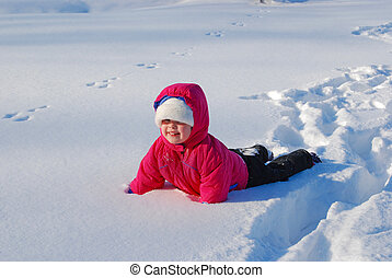 Snow Fall - Little girl fallen in the fresh snow