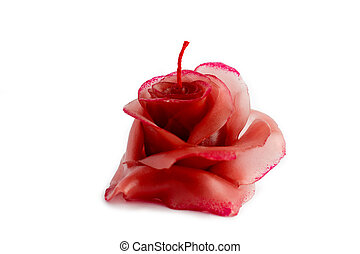 Red candle in the form of a rose on a white background