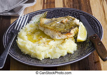 Fish with mash - Fried fish with lemony mashed potatoes on a...