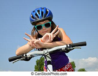 girl on bike - portrait of a girl on bike