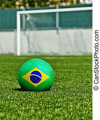 Soccer Ball with Brazilian Flag on the grass in stadium