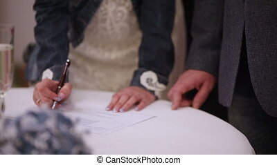 Marriage contract - Newlyweds sign a marriage contract