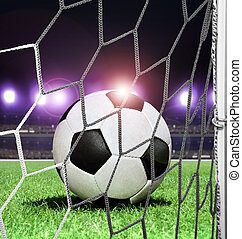ball on stadium at night - closeup soccer ball on green...