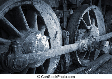 a rusty wheels of old steam locomotive