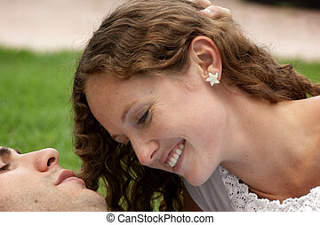 close up of beautiful shy woman smiling at her lover