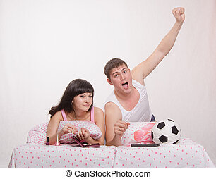 Celebrates after scoring husband, wife watch soccer - Young...