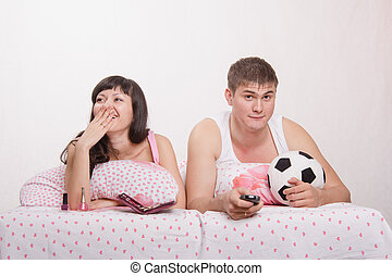 Husband watches football, frankly bored wife - Young girl...
