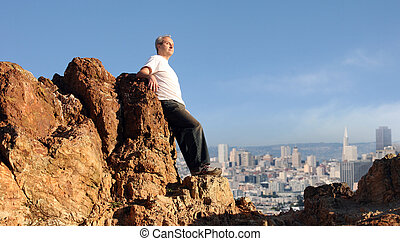 Man enjoying the view - A mature man enjoying the view of...
