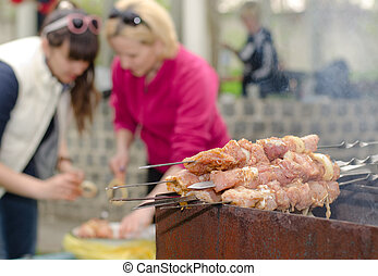 Kebabs ready for cooking on an outdoor BBQ - Kebabs ready...