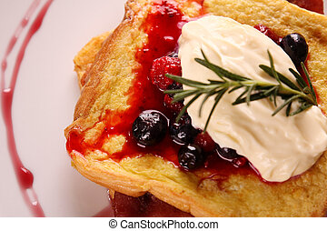 Delicious french toast with bacon syrup berries and cream on...