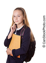 Serious schoolgirl in uniform and with bag