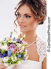 Wedding. Bride with bouquet - Wedding. Attractive bride with...