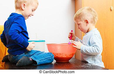 Boys kids children baking cake
