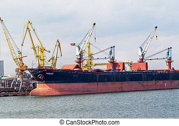 ODESSA, UKRAINE - APRIL 15: maritime cargo ship moored in...
