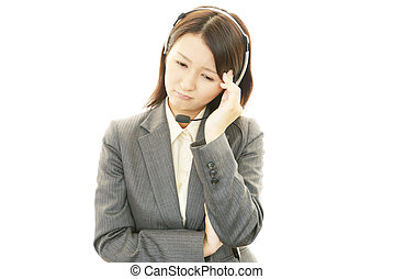 Young woman having a headache - Tired, sad business woman at...